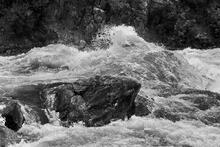 river channel, rocks, waves, spray