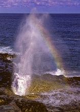 Spouting Horn,Kauai,lava rocks,coastline; rainbow