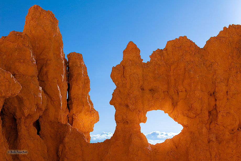 Morning light pours through a window in a fin along the Navajo Loop Trail near Inspiration Point.