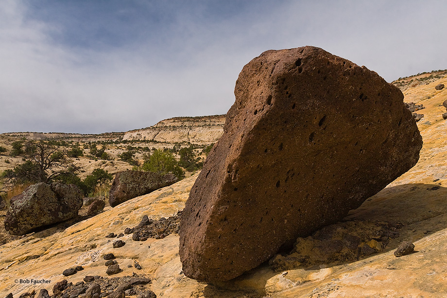 Lava boulders on the slick rock of Boulder Mountain, which makes up half of the Aquarius Plateau, testify to the mountain's volcanic...