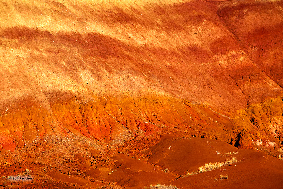 Morning sun on the bentonite hills makes them glow as if on fire.