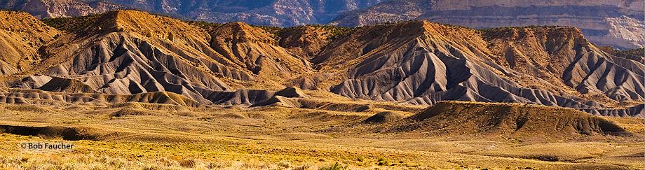 Badlands foothills, near Green River, Utah, below Book Cliffs with morning light