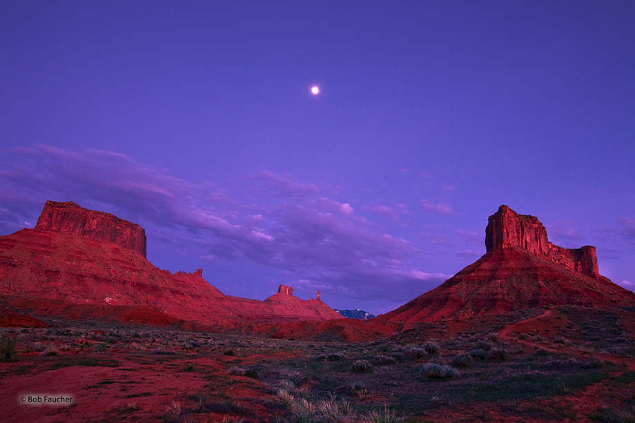 Castle Valley, located between Adobe Mesa and Porcupine Rim, with the moon balanced above