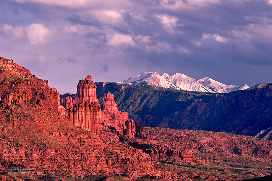 Fisher Towers glow their signature deep red with strong sidelight near the end of the day.