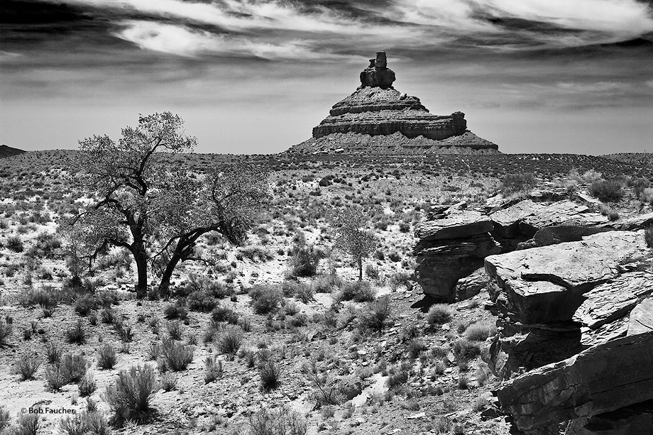 Franklin Butte stands in the open valley floor of Valley of the gods, a less-visited neighbor of Monument Valley. The formations...