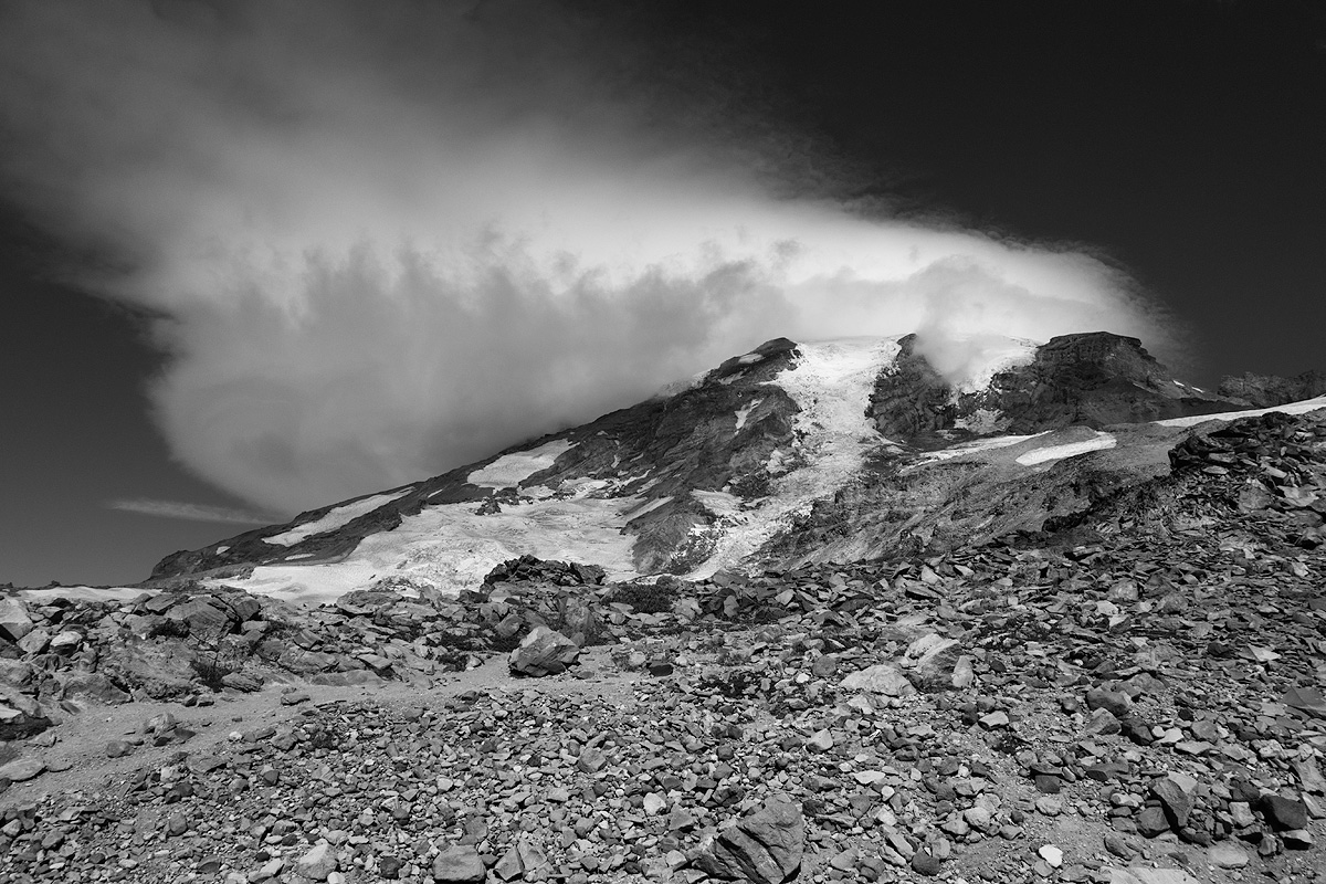Windswept summit of Mt. Rainier, crowned by a lenticular cloud