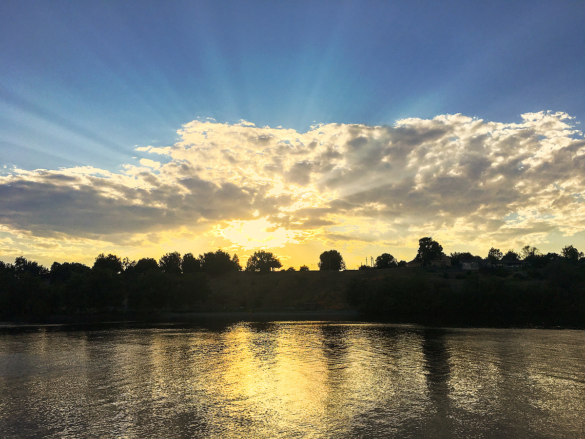 Early Fall sunset behind Clarkston, Washington, as seen from across the Snake River, producing widely-spread crepuscular rays...