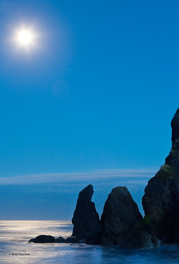 "On a calm late summer evening the nearly full moon creates a ""moonstar"" in a long exposure above some sea stacks at Ruby Beach..."