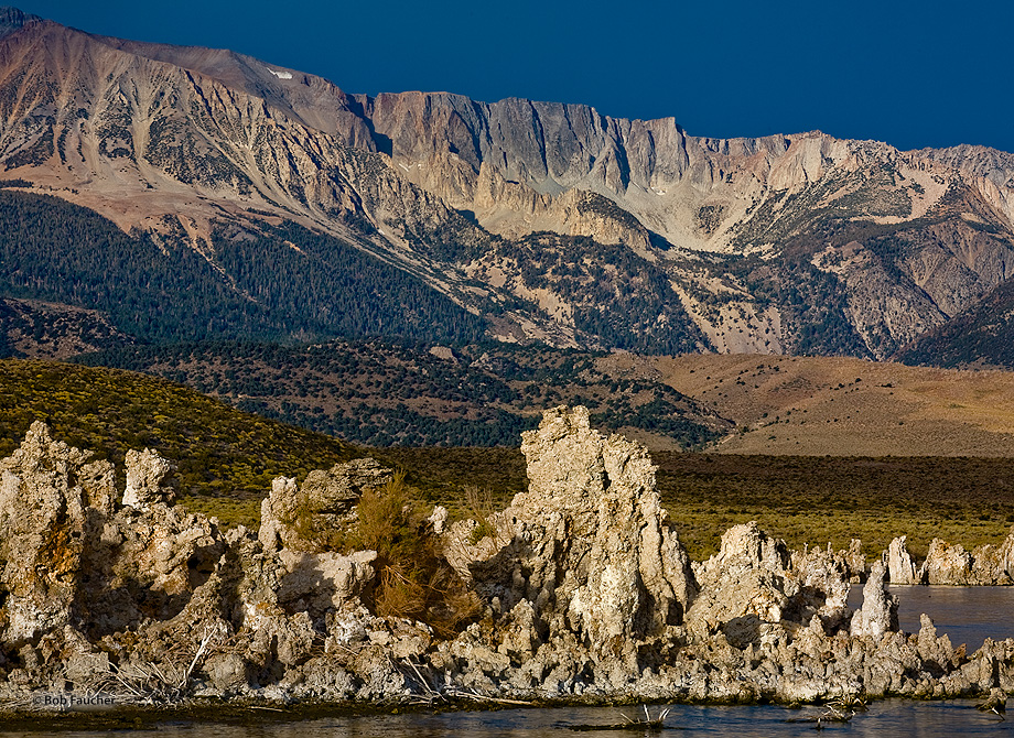Mid-morning light catches the sheer face of the Sierra Escarpment as it towers over tufa in Mono Lake