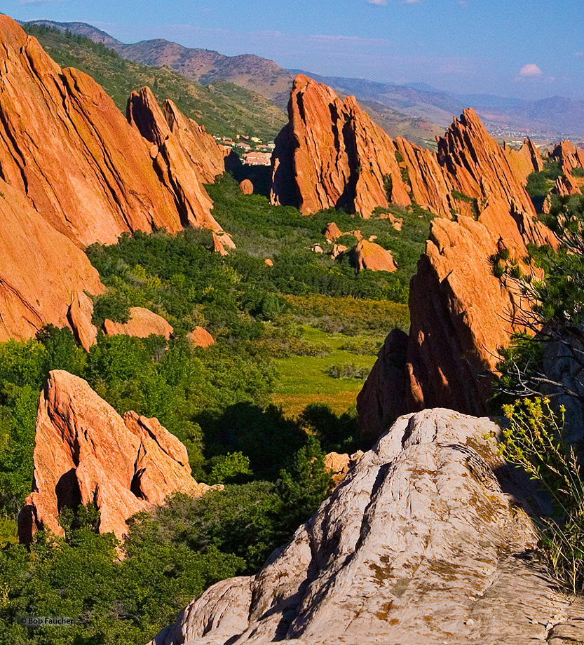 One round, smooth, white, upright rock formation seems so out of place among the angular, sharp, tipped, red sandstone formations...