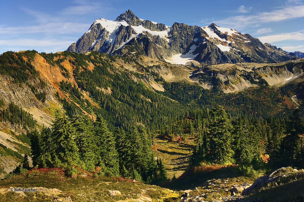 Mt Shuksan towers over Mt. Baker Wilderness in afternoon light in early Fall.
