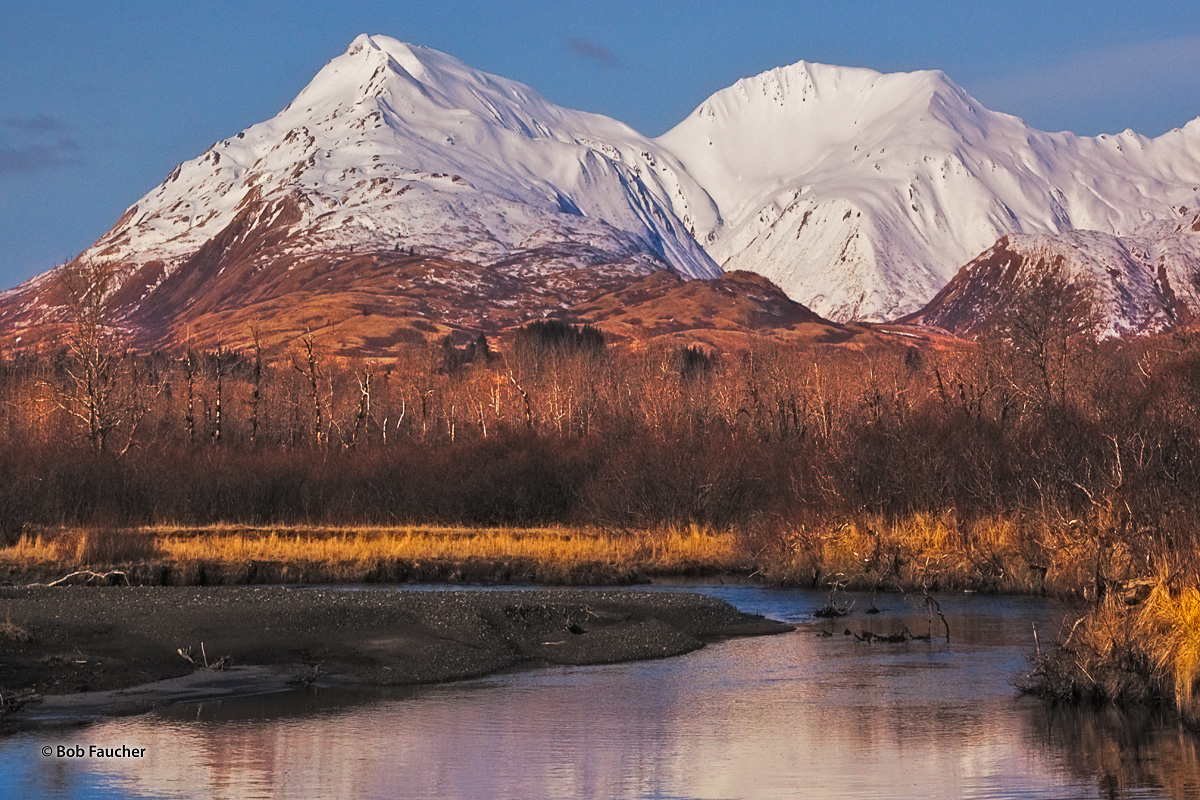 The Marin Range is reflected on the Olds River, which heads in an unknamed lake below the Range, as it flows NE 13 miles, the...
