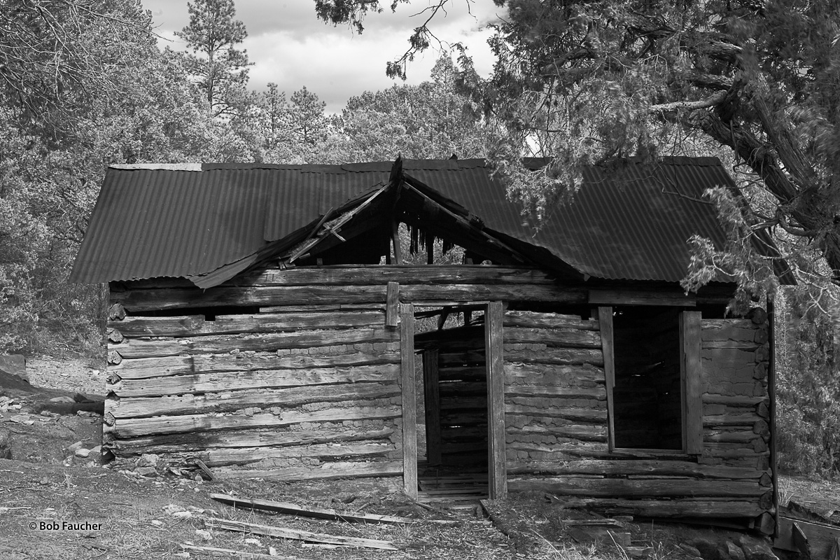 An abandoned cabin encountered along the way to Pecos Pueblo Mission in New Mexico. Corrugated, galvanized metal roofing has...