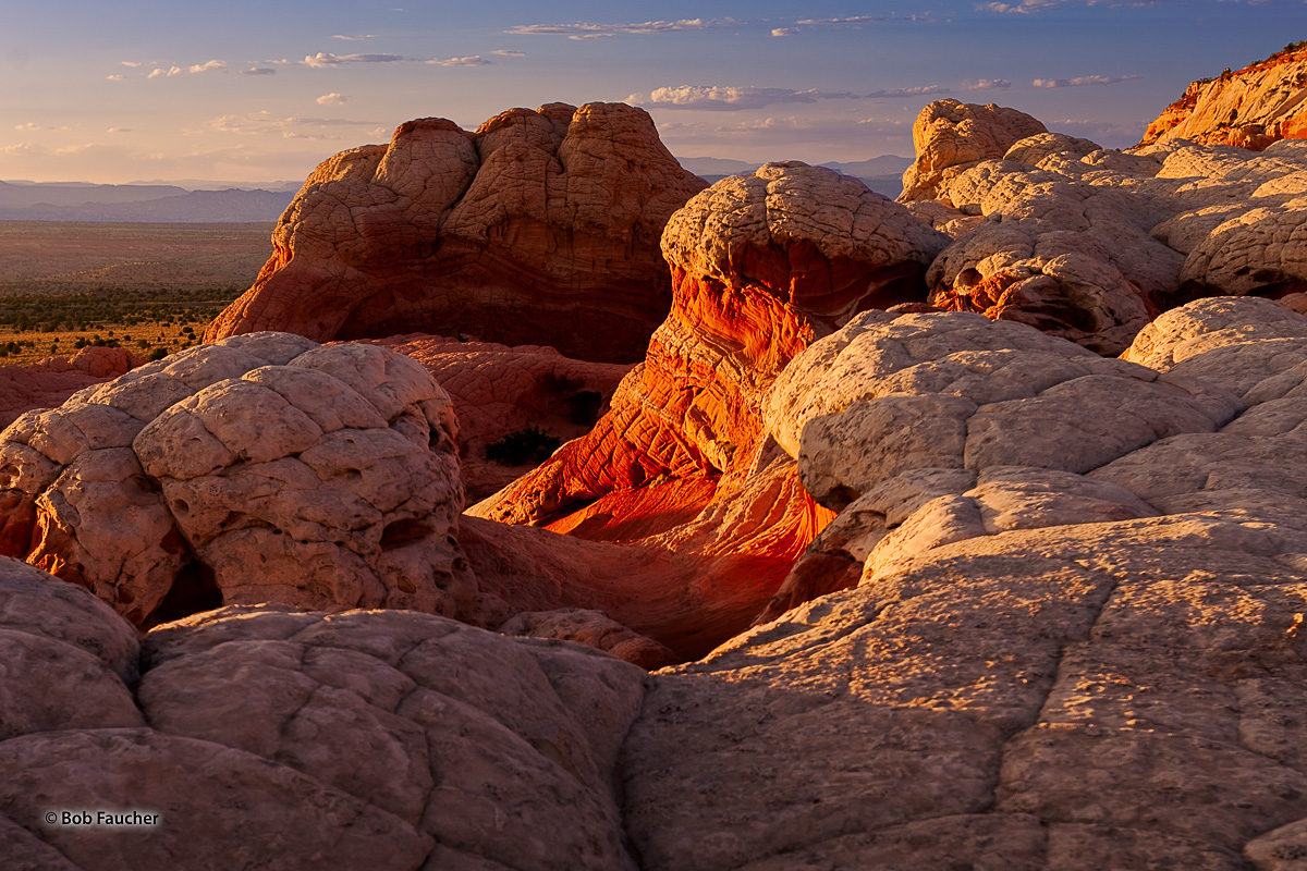 Below the brain rock superficial layers lies the richly-colored sandstone layers which tend to glow in the warm light of late...