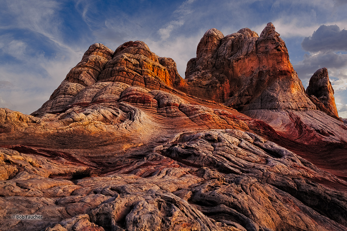 Low angle, late afternoon light emphasizes the textures and colors of the rock formations of White Pocket.