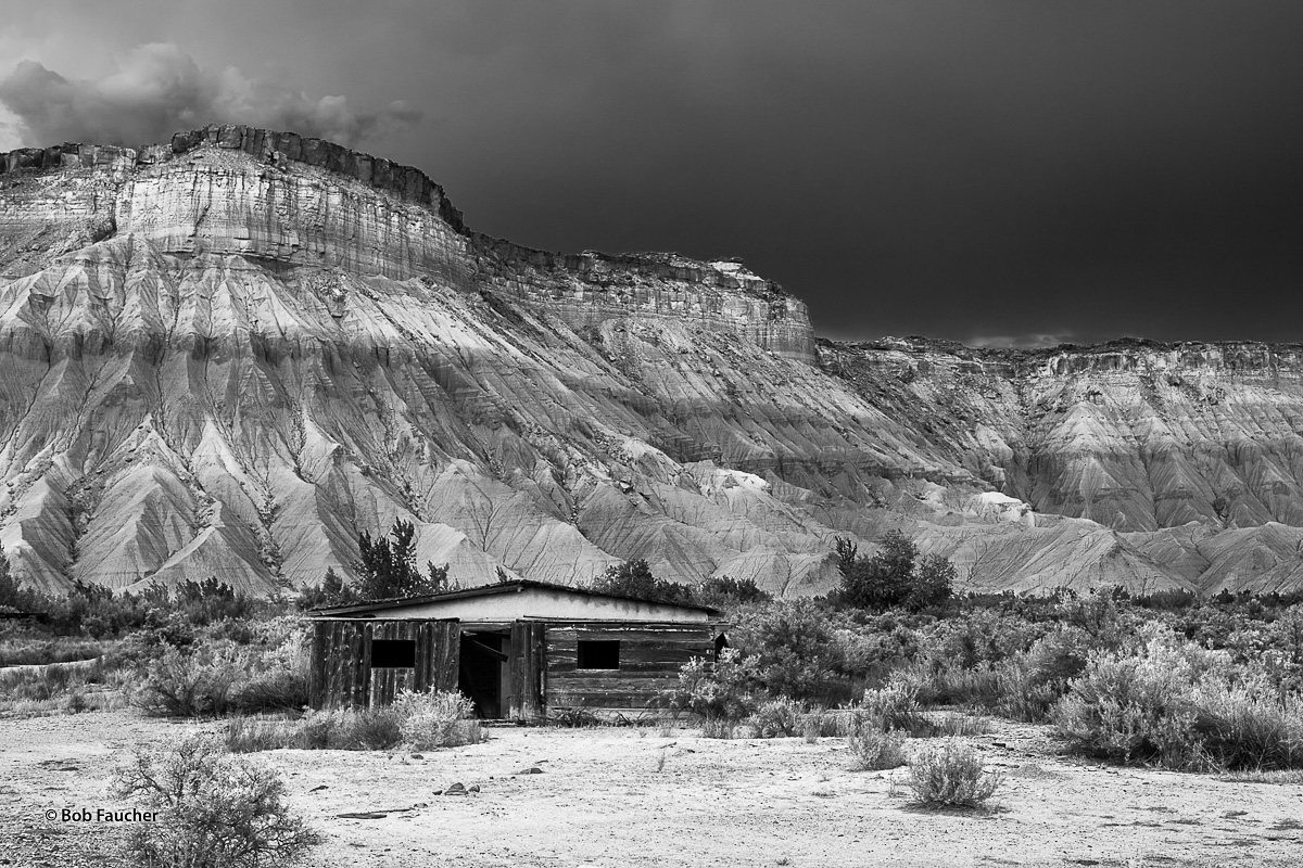 An abandoned building deteriorates at the base of the Upper Blue Hills near Hanksville, Utah