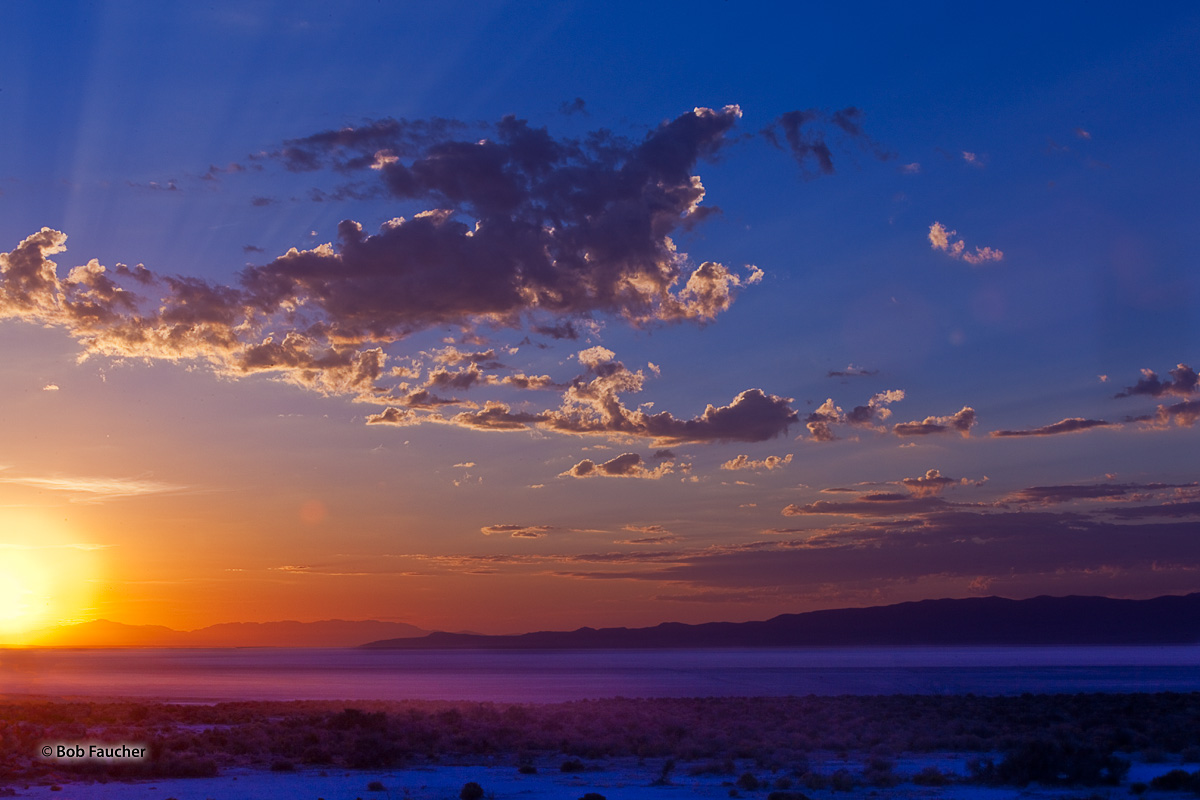 Sunrise over the Cricket Mountains in Utah floods the Wah Wah Valley with the colors of the rainbow—from red to violet they...
