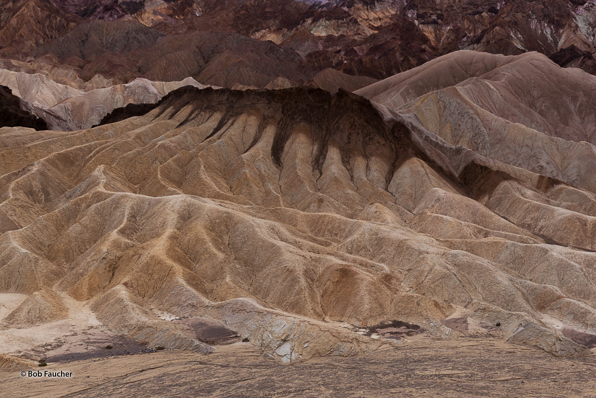 This butte-like portion of badlands in the Zabriskie Point area looks to this photographer like a hot fudge sundae with the fudge...