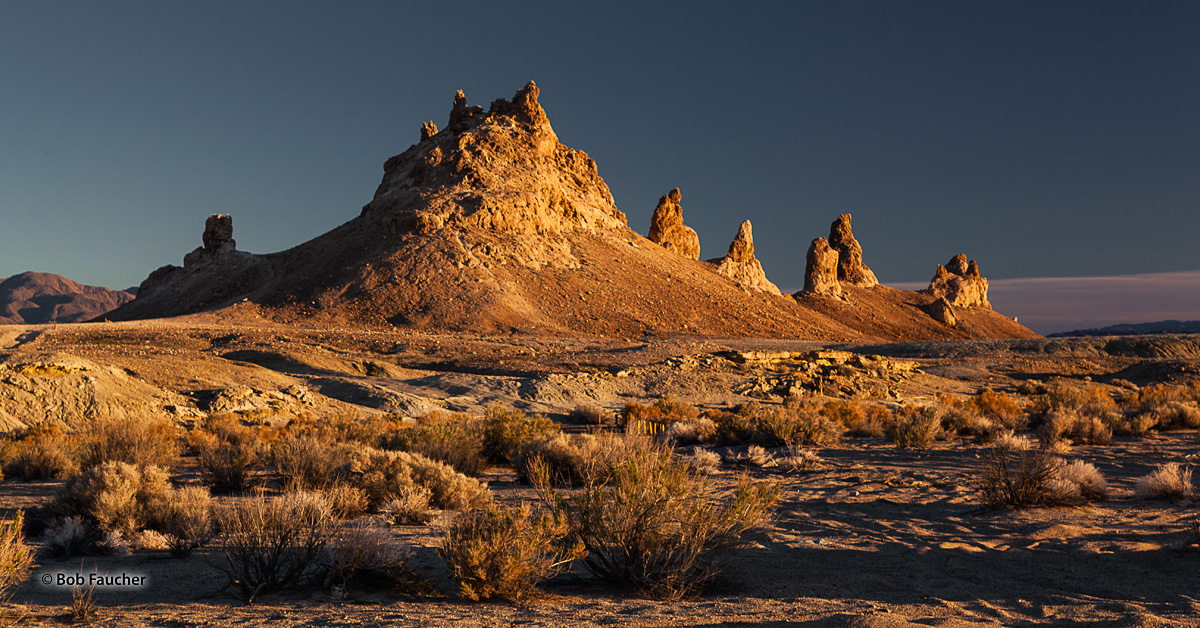Afternoon light bathes a few of the more than 500 tufa formations at Trona Pinnacles, some of these fantastic formations rise...