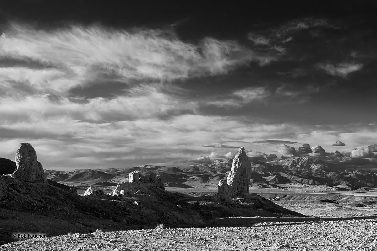 Late evening light casts lengthy shadows of some tall tufa spires in Trona Pinnacles, a National Natural Landmark in the Searles...