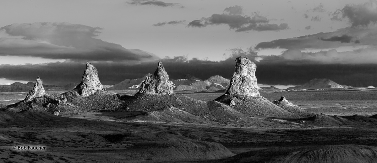 Morning light catches a lineup of tufa spires in Trona Pinnacles, a National Natural Landmark in the Searles Lake Basin of the...