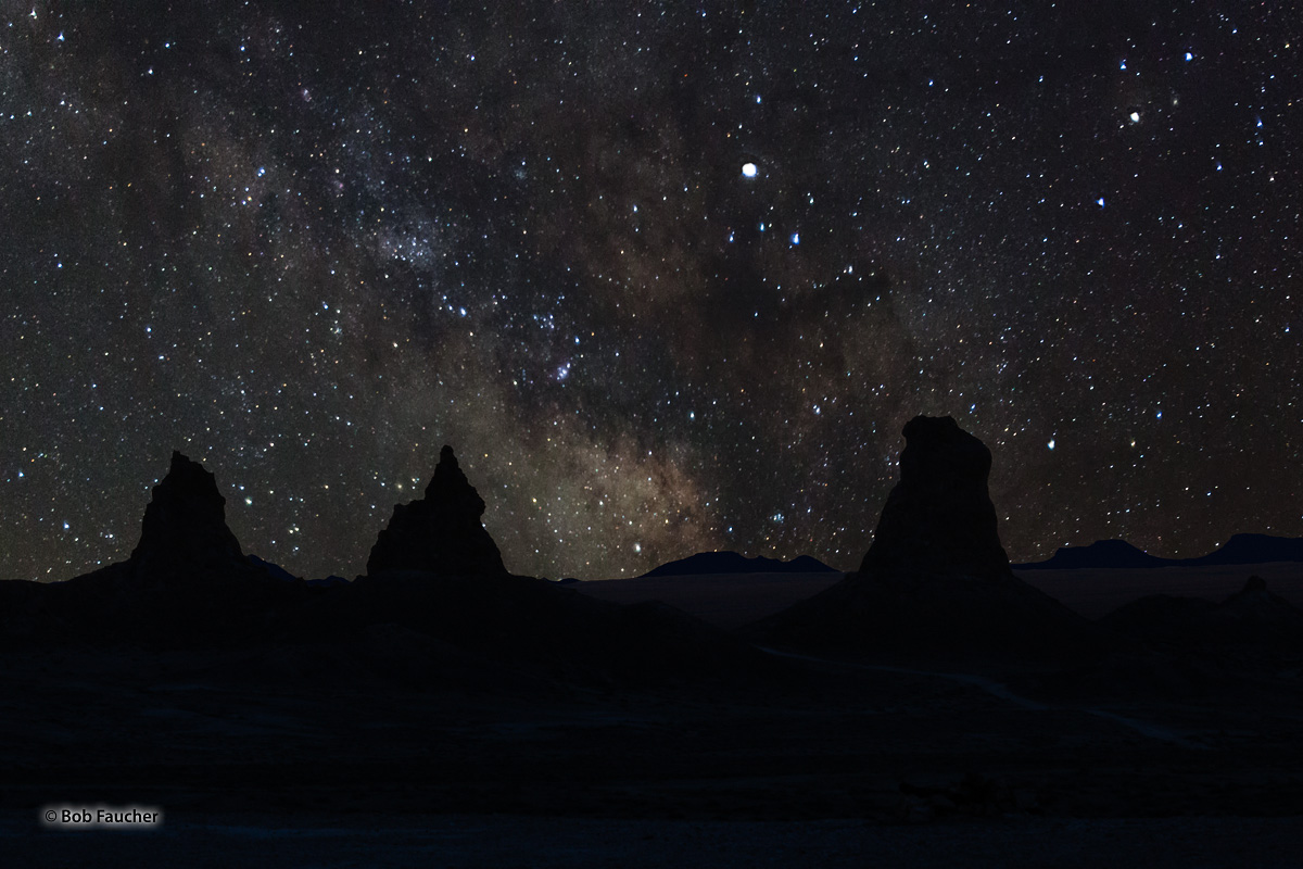 Milky Way display over a trio of tufa towers in Trona Pinnacles, a National Natural Landmark in the Searles Lake Basin of the...