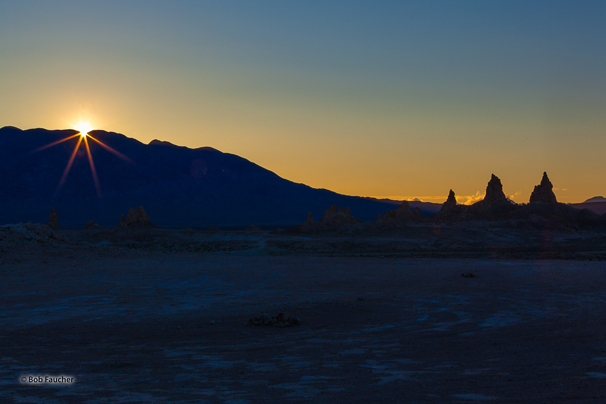 The sun breaks over the Slate Range, heralding a new day in Trona Pinnacles, a National Natural Landmark in the Searles Lake...