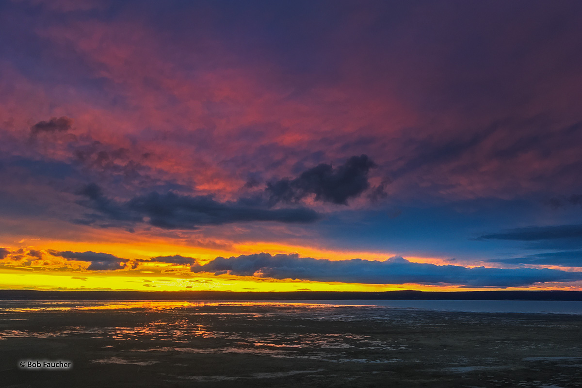 Colorful sunset over Goose Lake, in the Goose Lake Valley on the Oregon–California border in the United States. Like many other...