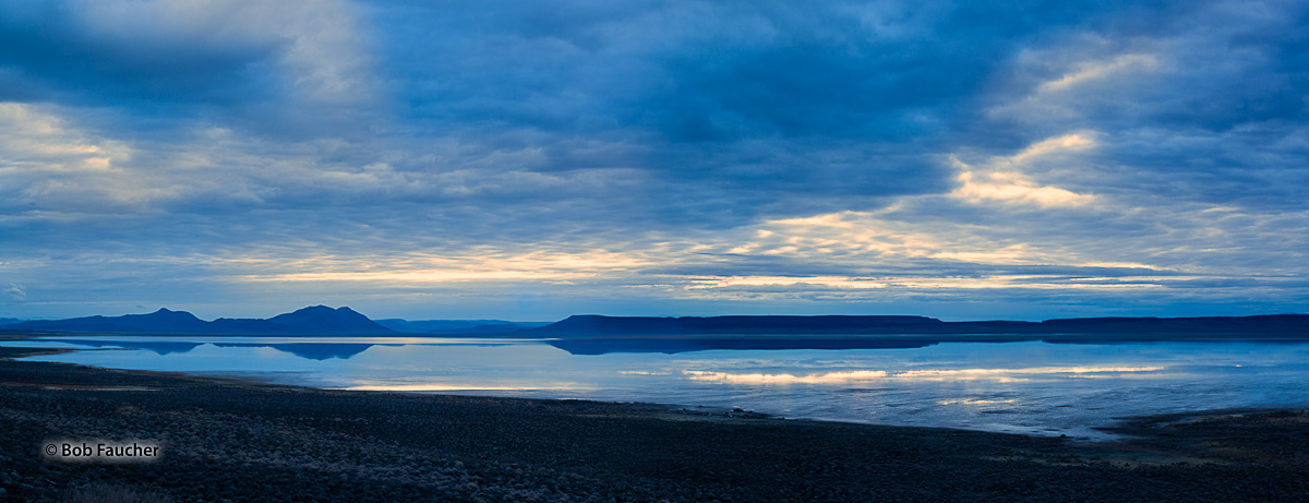 Recent heavy snowmelt runoff has enlarged the lake in the floor of the Alvord Desert. Early morning Blue Hour, with the warm...