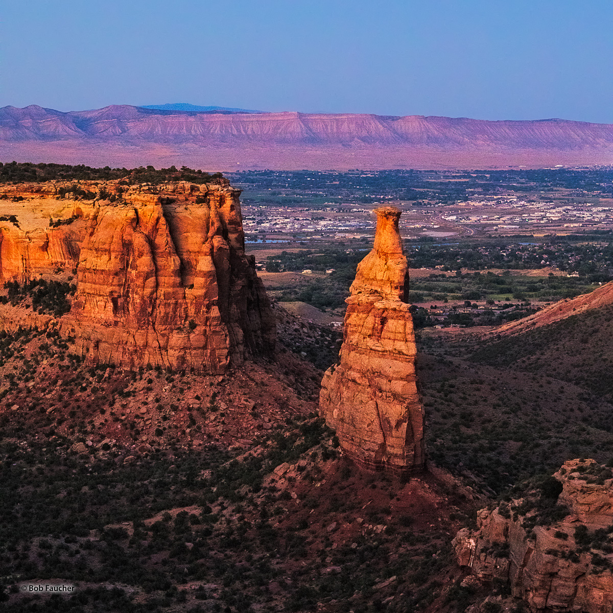 Independence Monument, glowing with the warm light of dusk, is perhaps the most impressive rock formation found in Colorado National...