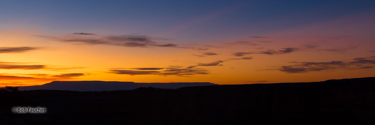 View of Grand Mesa's silhouette at dawn as seen from Colorado NM