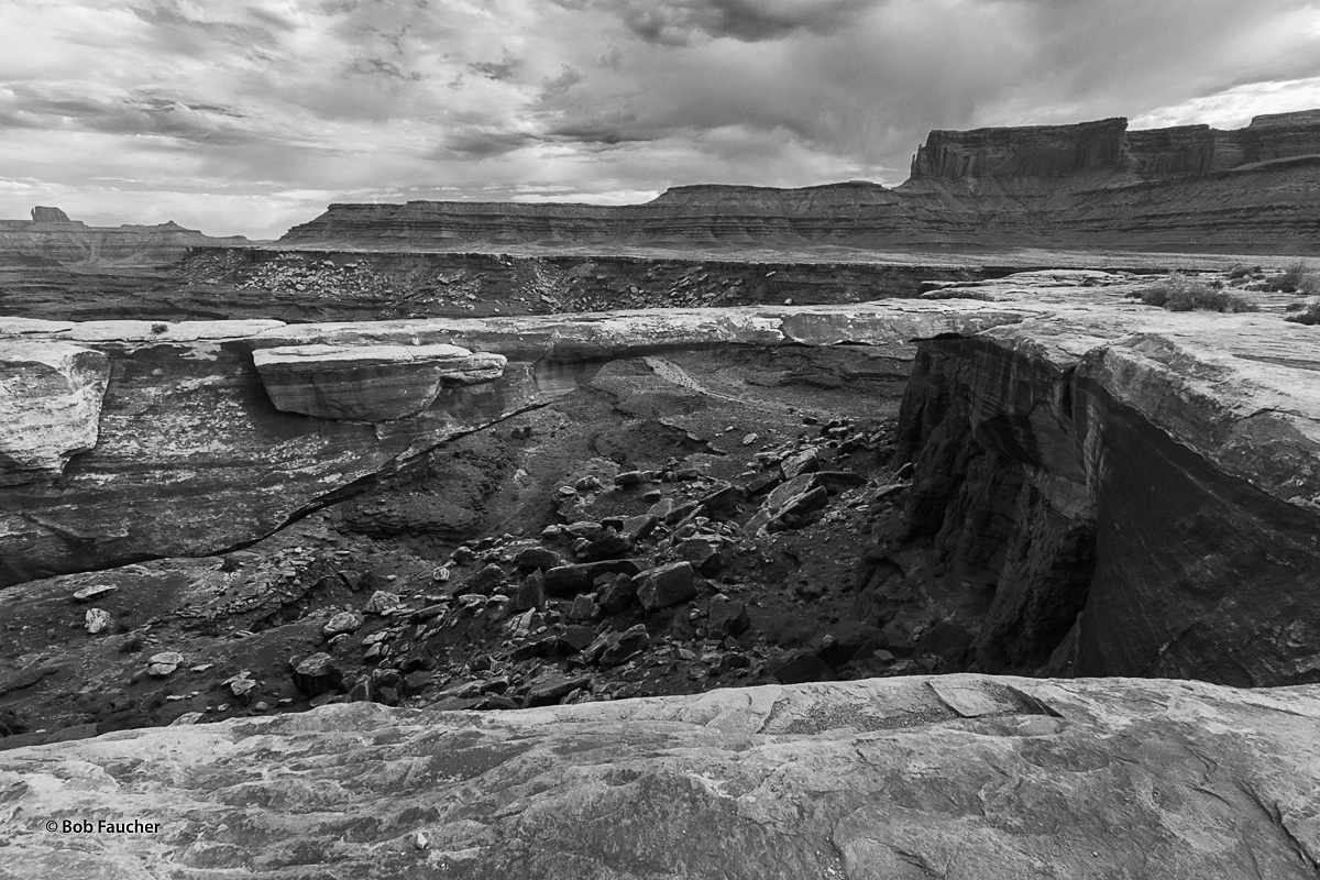 This side canyon to the Colorado River, as it courses its way through Canyonlands NP, has a natural bridge across a smaller side...