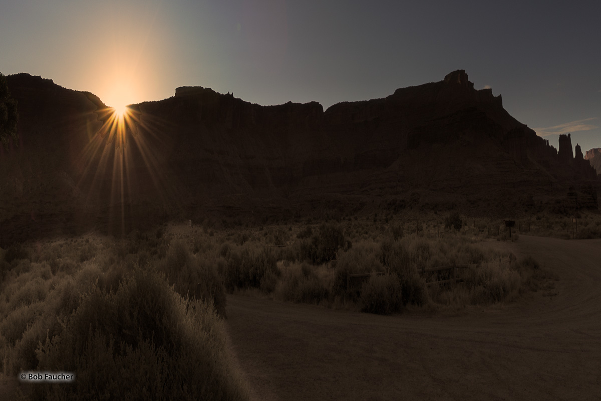Sunrise breaks over Sevenmile Mesa, east of Richardson Amphitheater. To the extreme right of the image and still in deep shadows...