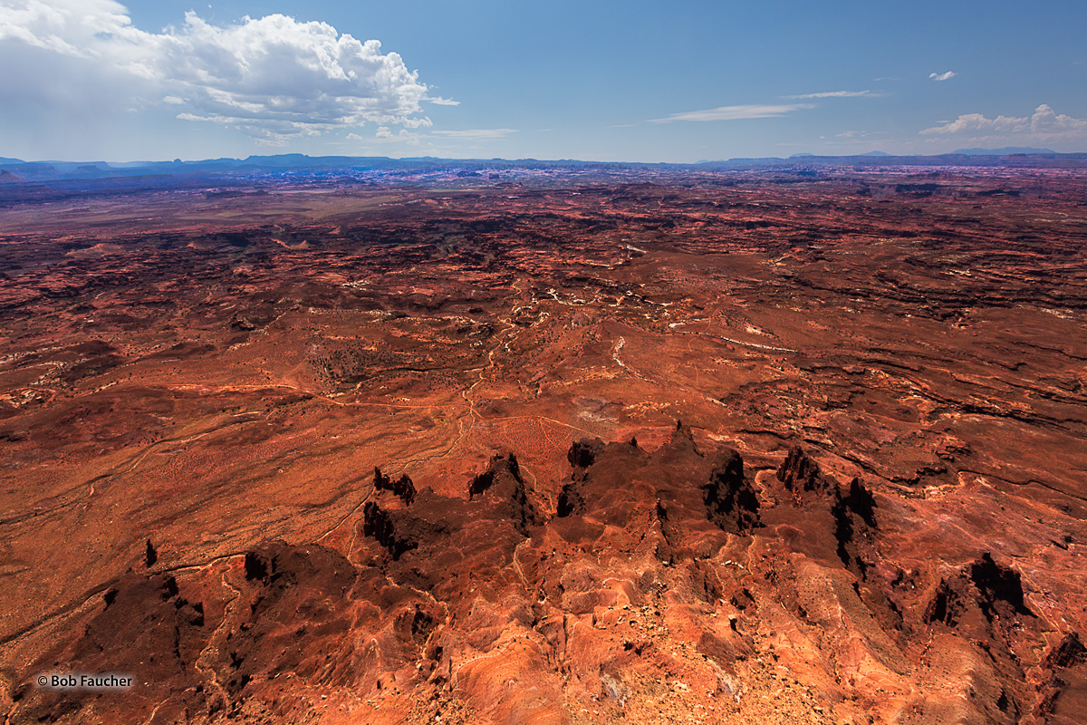 Barren expanses of the Needles section of Canyonlands NP. Near the horizon is the Island in the Sky section.