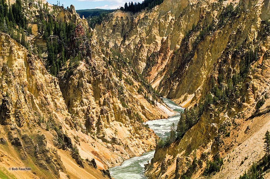 Below the Lower Falls, the Yellowstone River passes Red Rock Point, a favorite place to observe and photograph the falls from...
