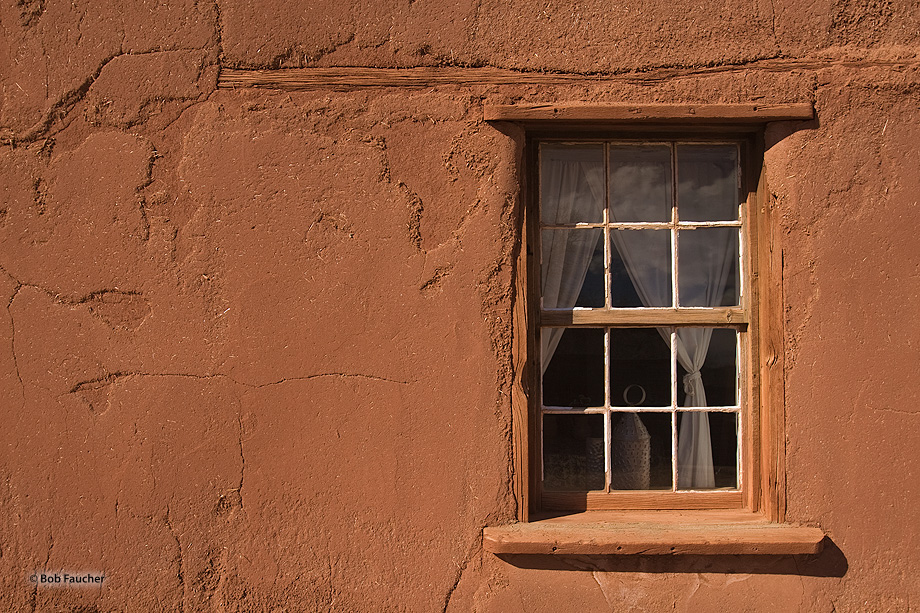 A window into one of the residences facing the central plaza of El Rancho de Las Golondrinas, a living history museum.