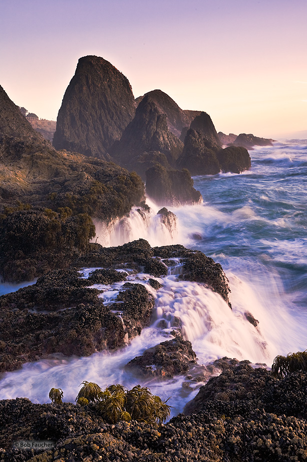 Water that had been deposited on the rocks by the crashing surf falls back into the sea