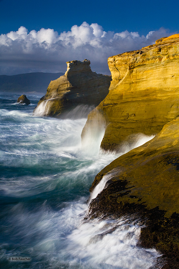 The headlands of Cape Kiwanda have troughs formed in their walls as the surf swells line up to fuel the continuous erosion