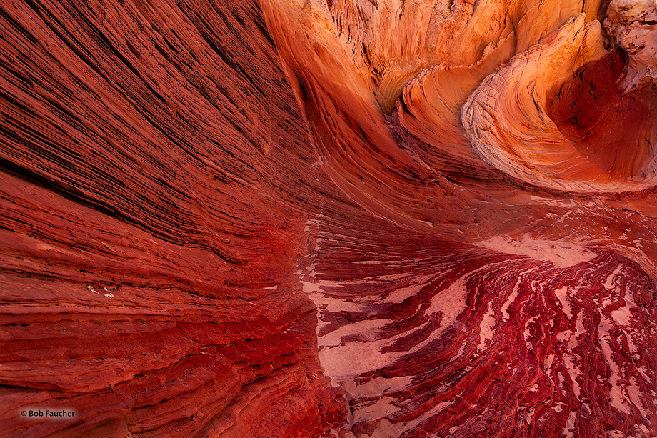 Swirling patterns of stone formed by water over milennia