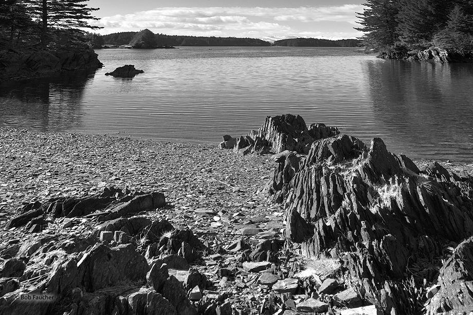 Shale rocks, visible and negotiable on foot only at low tide, lead your eye from Near Island out to Twin Islet