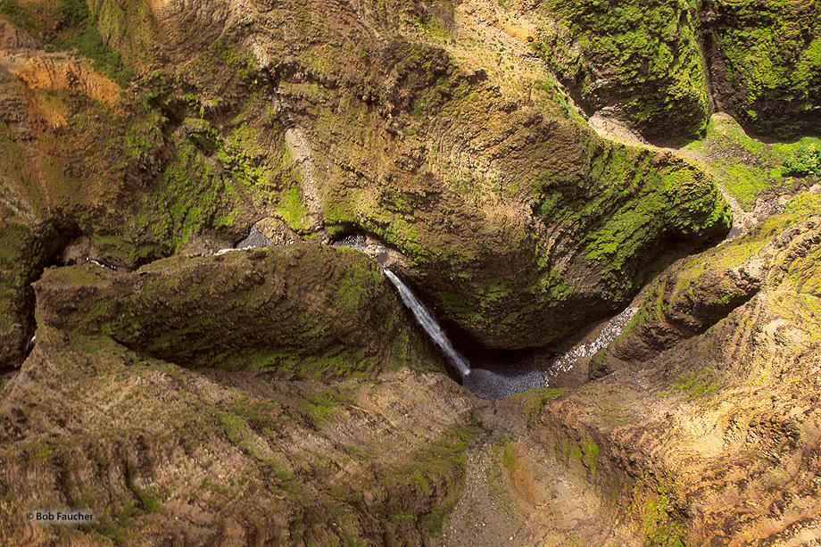 Looking down into Wiamea canyon from a helicopter above Waipo'o Falls. I asked the pilot to flip the bird over on its side as...